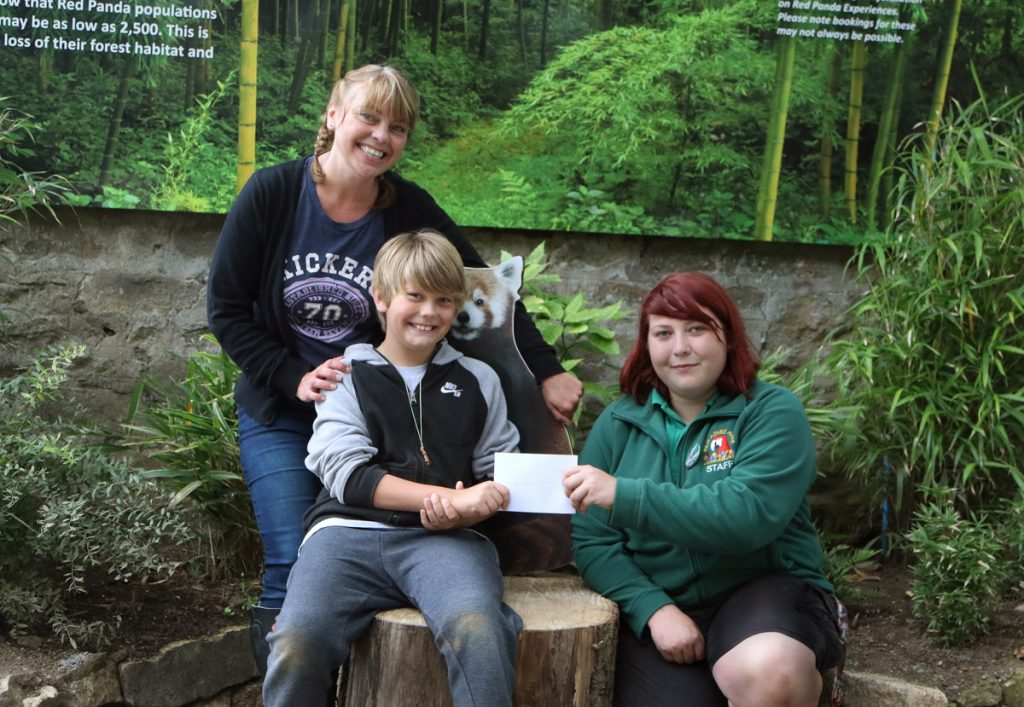 Alex presents cheque to Red Panda Keeper Ashleigh