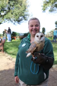 Keeper Sarah-Jayne Cooke with Evan the Barn Owl at Paradise Park in Hayle