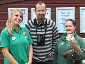 Mark Grantham with Paradise Park keepers Sophie and Leanne