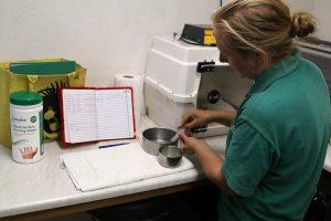 Becky preparing food behind the scenes